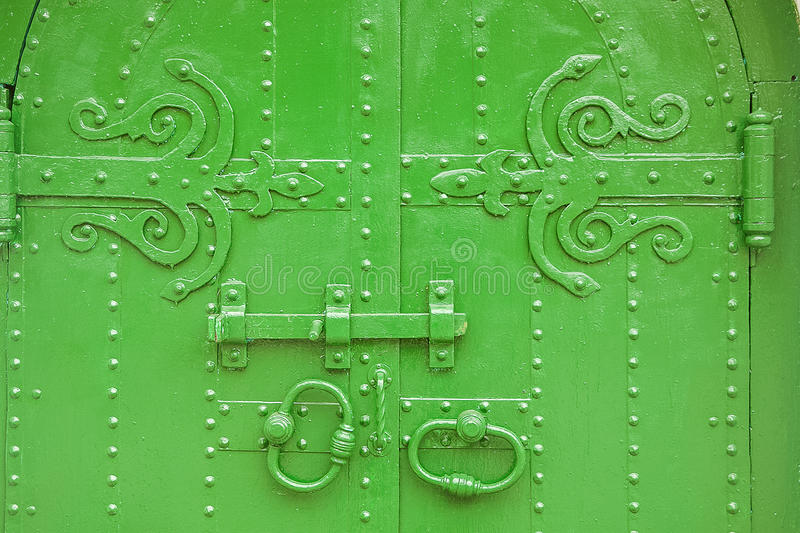 Green shod ancient gate. In Russia stock image