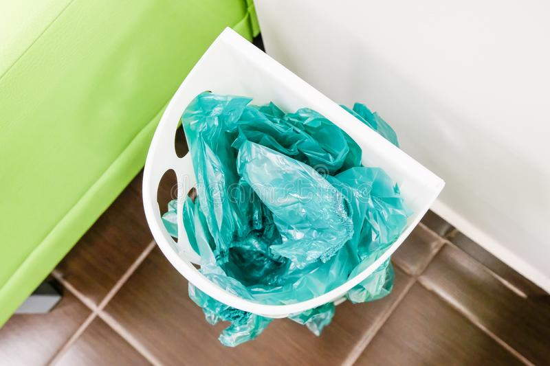 Green shoe covers in a basket. Disposable shoe covers at the medical center royalty free stock photos