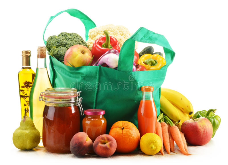 Green shopping bag with grocery products on white stock photo