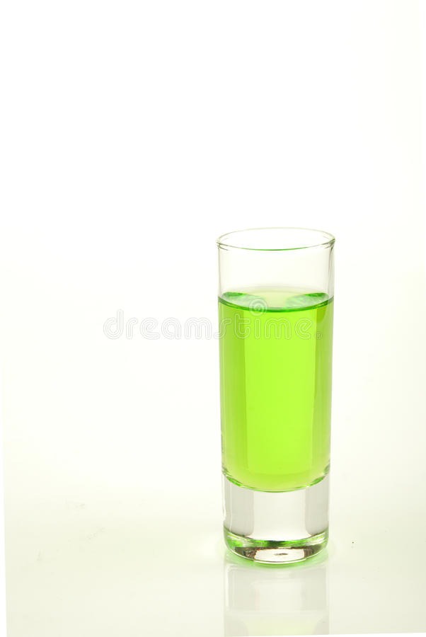 Green shot of absinth stock photography
