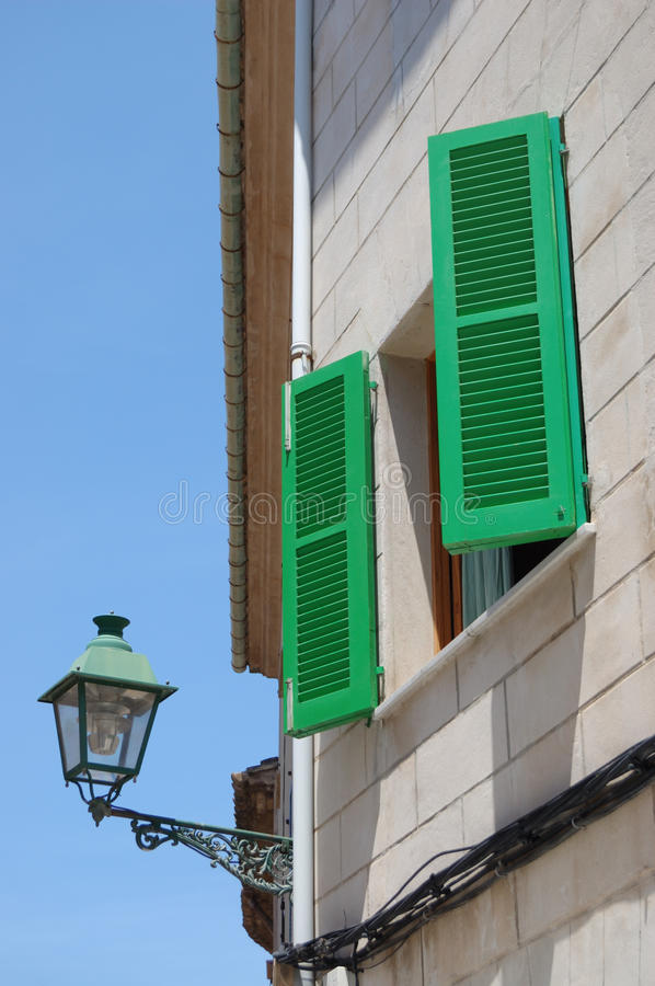 Green shutters. Brightly painted green shutters, Pollensa, Mallorca royalty free stock photography