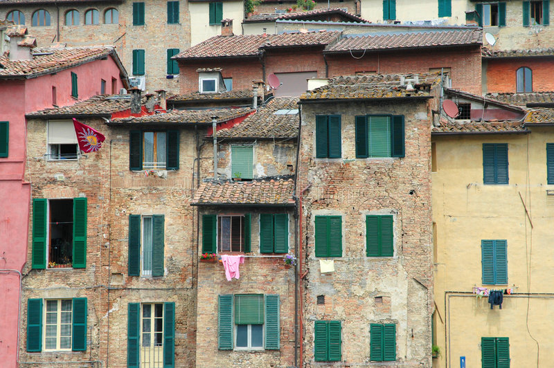 Green shutters in Tuscany old city. Old city with green shutters - Siena Italy royalty free stock images