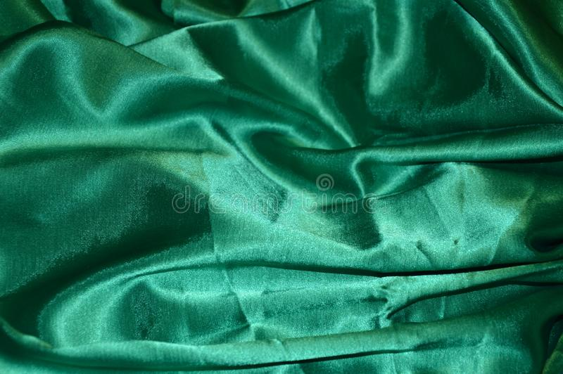 Green silk background. Textile satin royalty free stock images