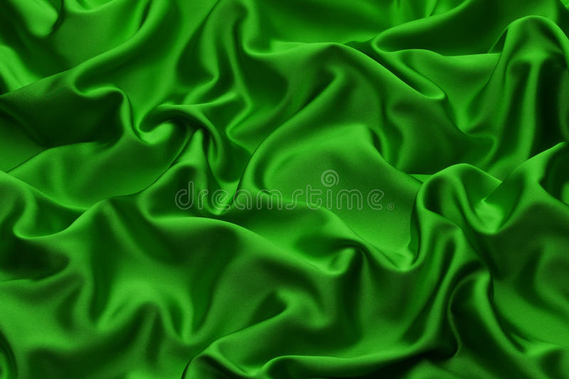 Green Silk. Background with soft folds and ruffles royalty free stock image