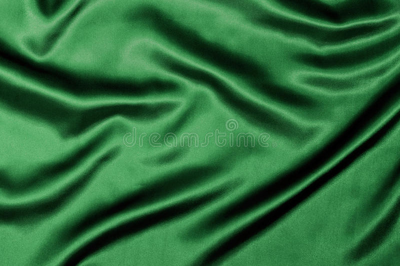 Green Silky Background texture. Green Silk background texture with wavy ripples to enhance the sheen of the fabric royalty free stock image