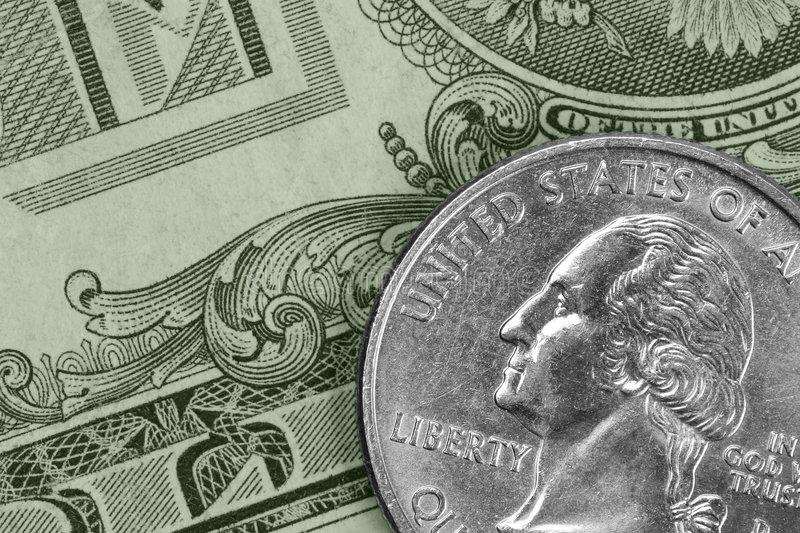 Green and silver. Closeup of U.S. money: a quarter and a dollar bill stock images
