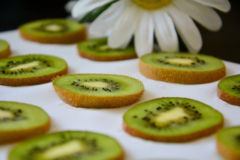 Green slices of Kiwi fruit on white background. royalty free stock image