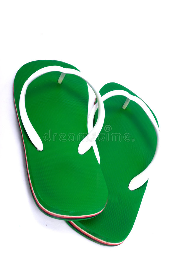 Green slippers. Slippers isolated on white background royalty free stock images