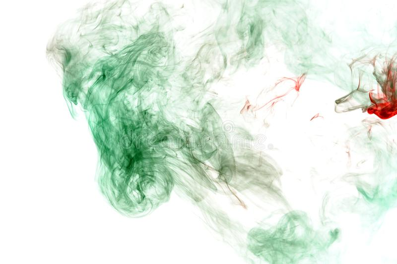 Green smoke or ink pattern on a white isolated background. Print for clothes. Disease and viruses. Wavy green smoke or ink pattern on a white isolated background royalty free stock image
