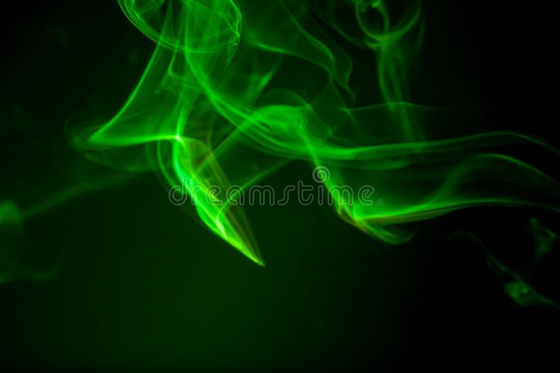 Green smoke motion on black background. Abstract, air, art, artistic, backdrop, burn, cigarette, color, colorful, concept, conceptual, creativity, curve stock photo