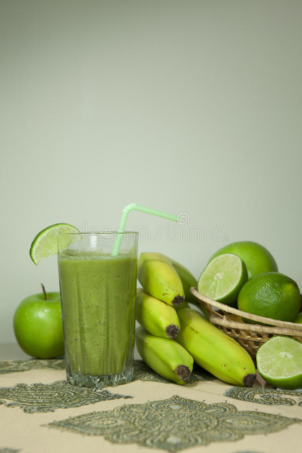 Green smoothie. Delicious vegetable and fruit smoothie stock images