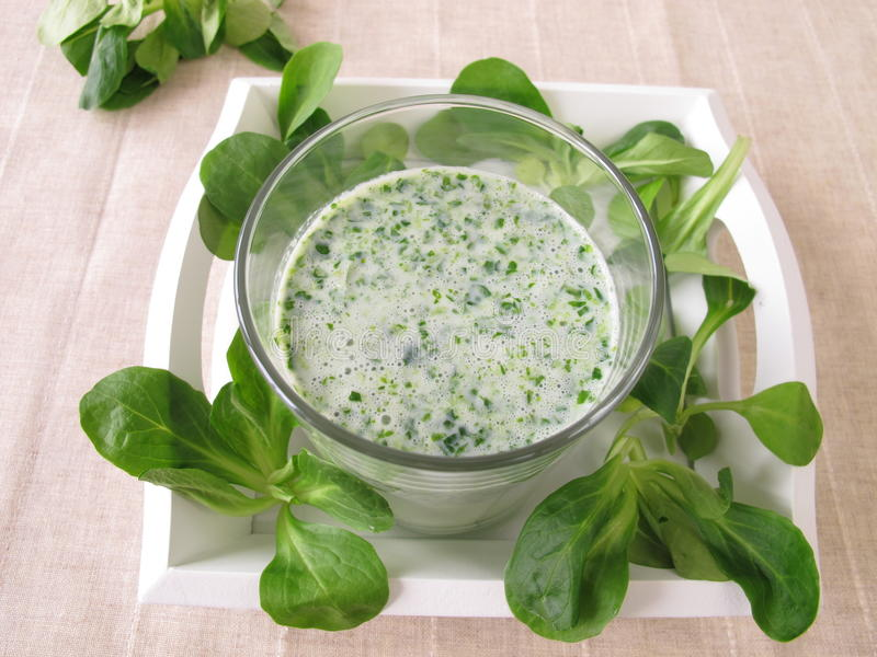 Green smoothie with corn salad royalty free stock photo