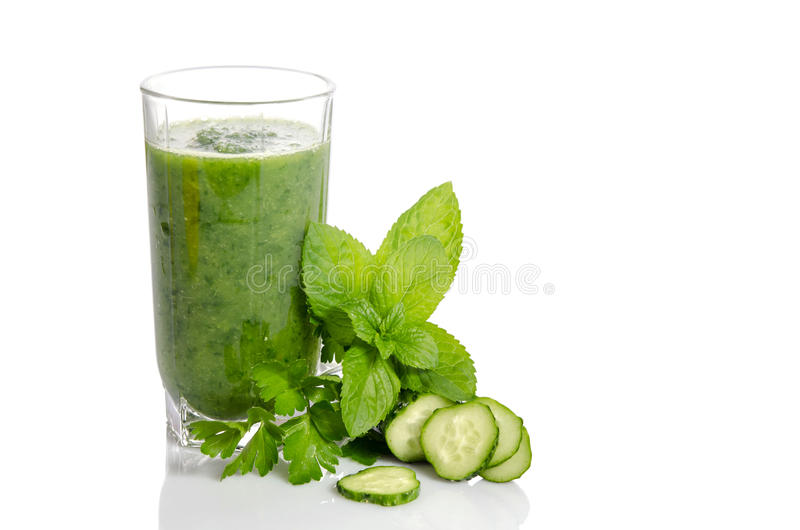 Green smoothie with cucumber, mint and parsley. As healthy summer drink on white stock photography