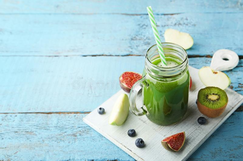 Green smoothie in glass jar stock image