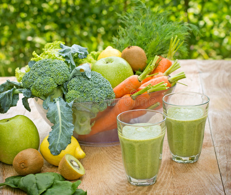 Green smoothie (green juice). On table royalty free stock photo