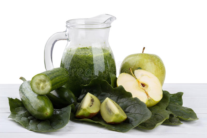 Green smoothie. Healthy green smoothie with spinach,green aple,kiwi and cucumber royalty free stock image