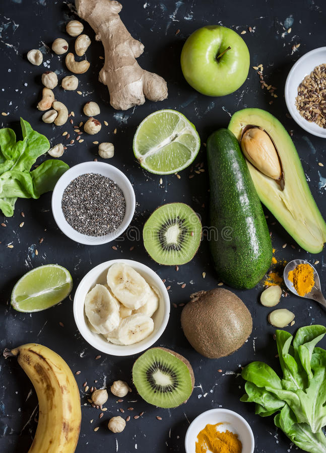 Green smoothie ingredients. Cooking healthy detox smoothies. On a dark background. Top view royalty free stock images