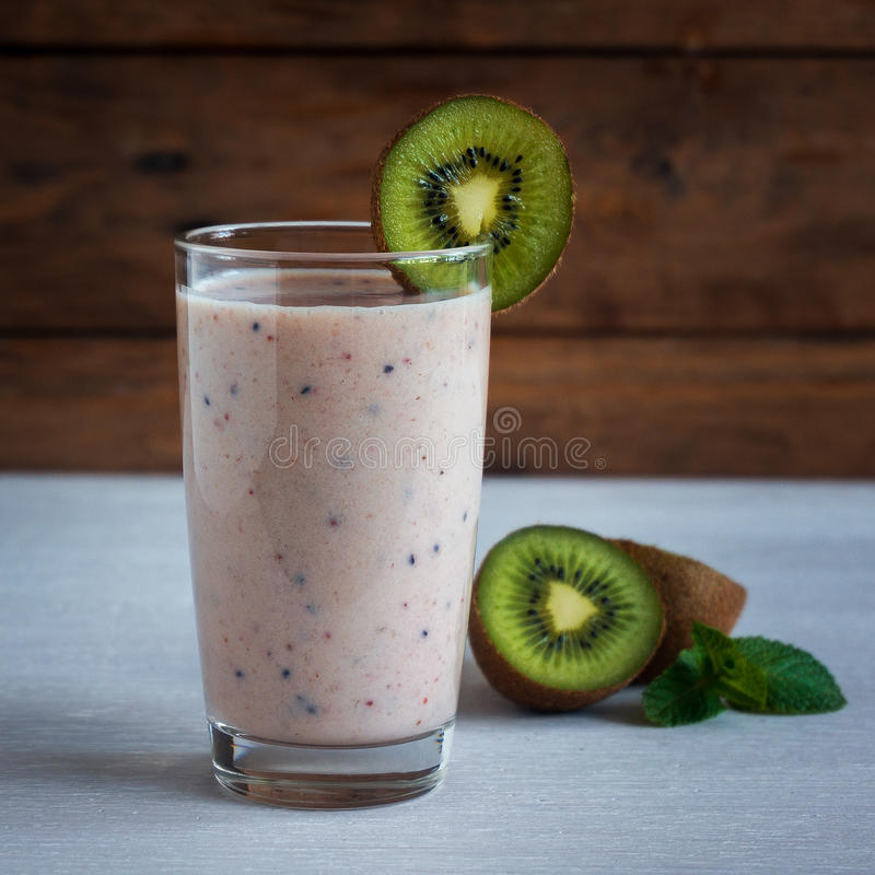 Green smoothie kiwi banana and strawberry, healthy eating, superfood royalty free stock photos