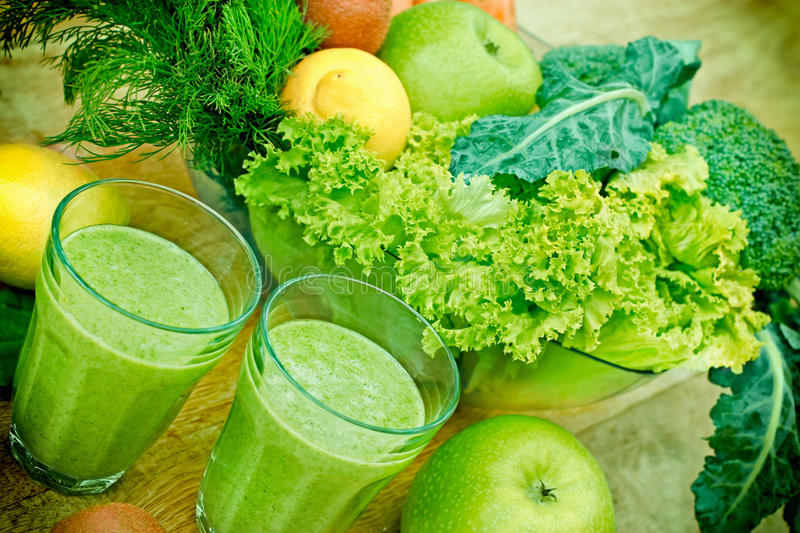 Green smoothie (organic smoothie). Two glasses of healthy green smoothie on table royalty free stock images