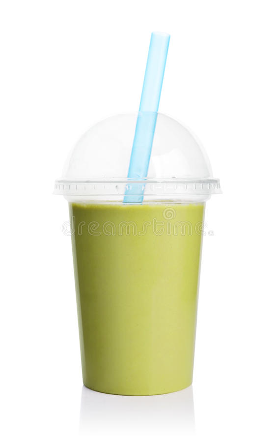 green smoothie in plastic transparent cup stock photo