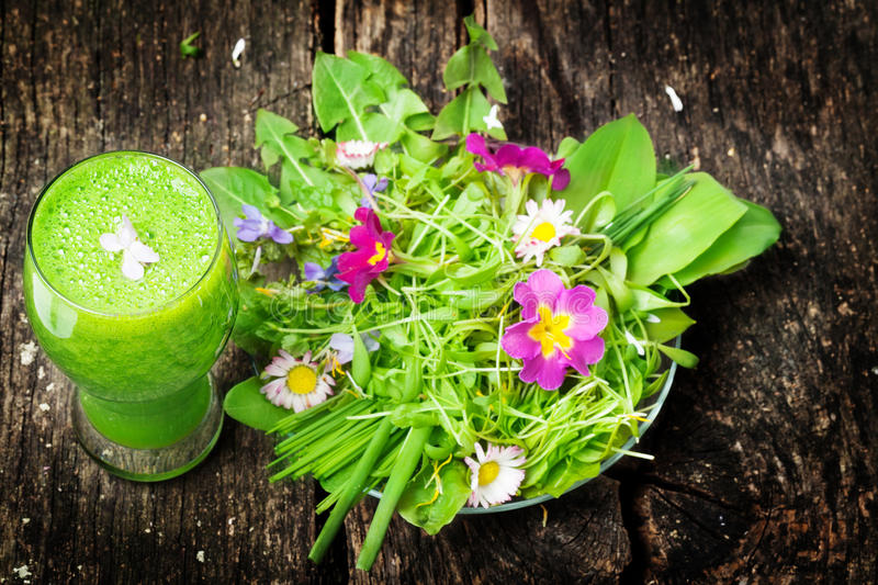 Green smoothie, salad of wild herbs royalty free stock photography