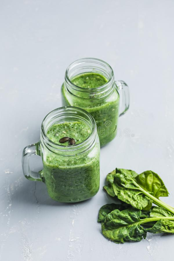 Green smoothie with spinach, Apple, cucumber and coconut milk royalty free stock photo