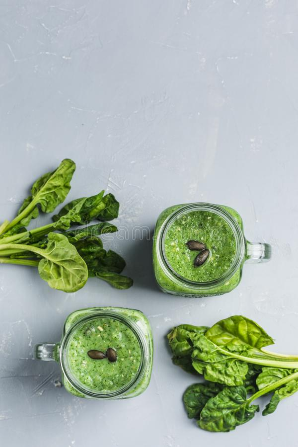 Green smoothie with spinach, Apple, cucumber and coconut milk stock images