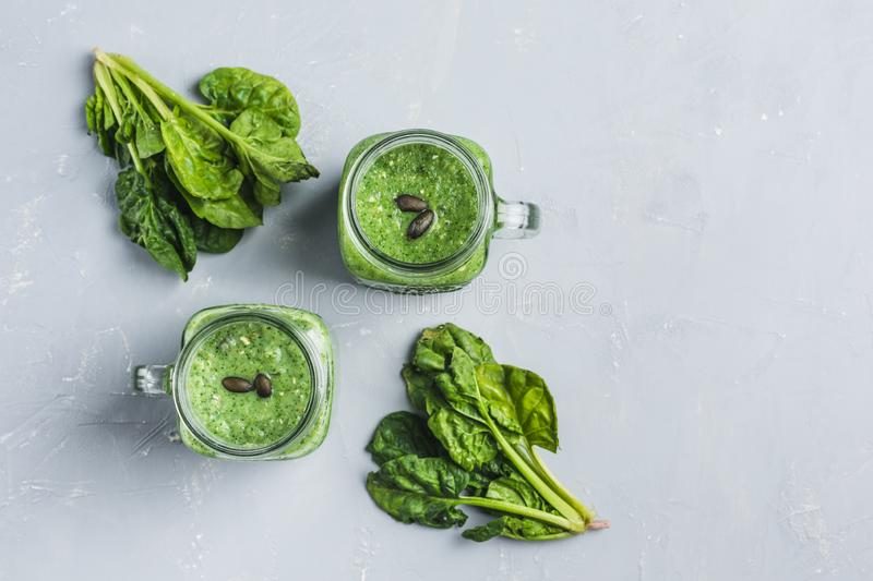 Green smoothie with spinach, Apple, cucumber and coconut milk stock photography