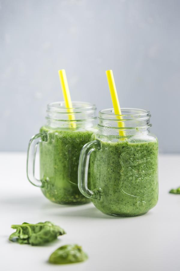 Green smoothie with spinach, Apple, cucumber and coconut milk stock photos