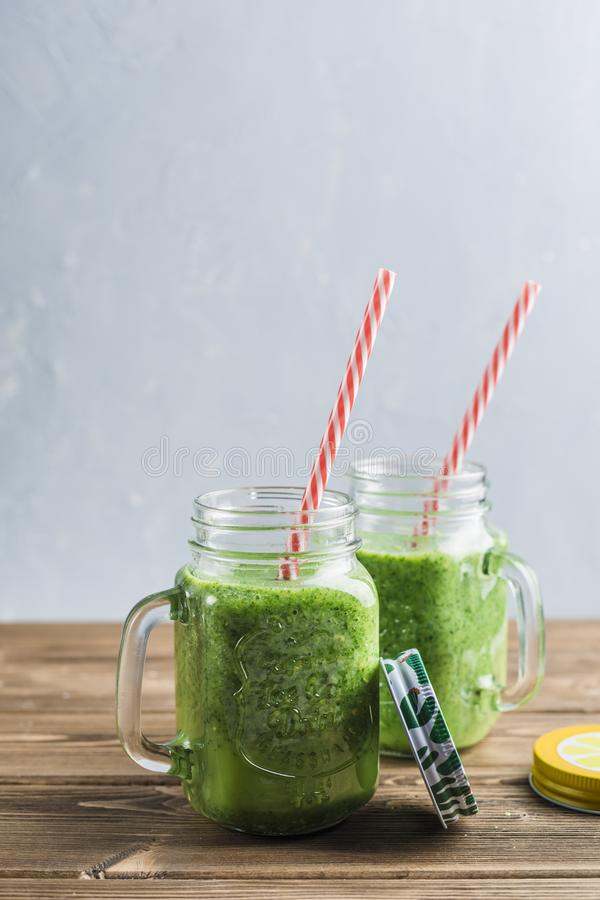 Green smoothie with spinach, Apple, cucumber and coconut milk stock image