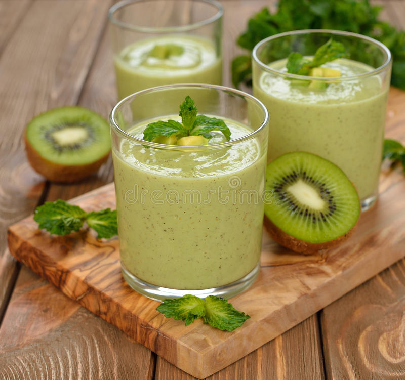 Green smoothies. On a brown background stock photo
