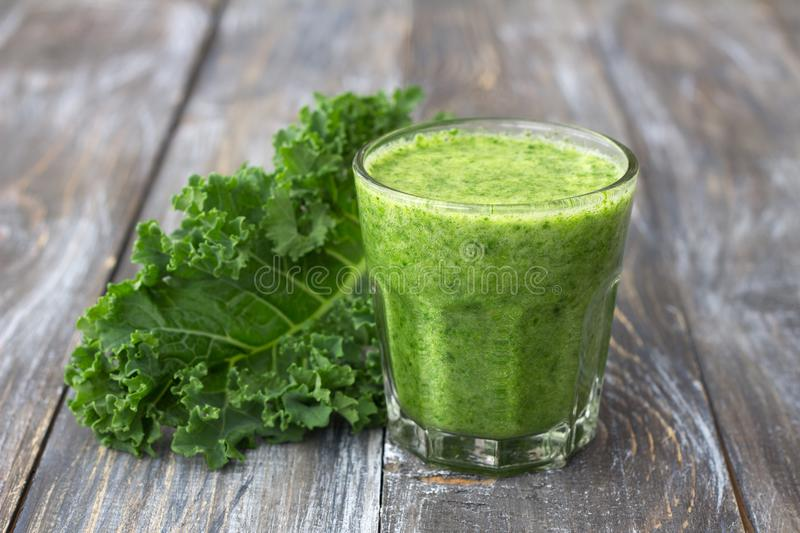 Green smoothies with kale, banana and lemon. On a wooden table. selective focus. healthy diet food stock photography