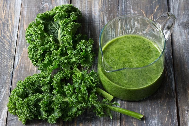 Green smoothies with kale, banana and lemon. On a wooden table. selective focus. healthy diet food stock images