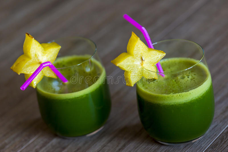 Green smoothies with starfruit. Two green smoothies with a slice of a carambola stock photos