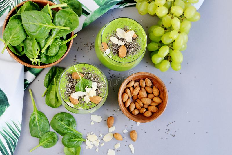 Green Smoothies Vegetables Spinach Apple Grape with Chia Seeds and Almonds. Healthy Food Concept, Detox royalty free stock photos