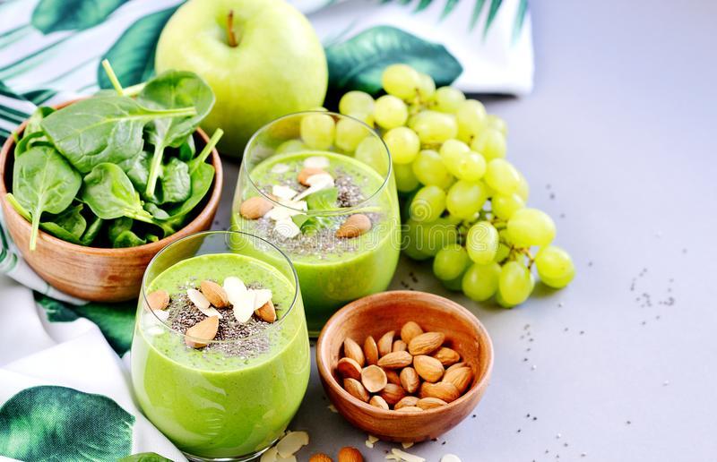 Green Smoothies Vegetables Spinach Apple Grape with Chia Seeds and Almonds. Healthy Food Concept, Detox royalty free stock photography