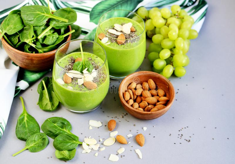 Green Smoothies Vegetables Spinach Apple Grape with Chia Seeds and Almonds. Healthy Food Concept, Detox royalty free stock image