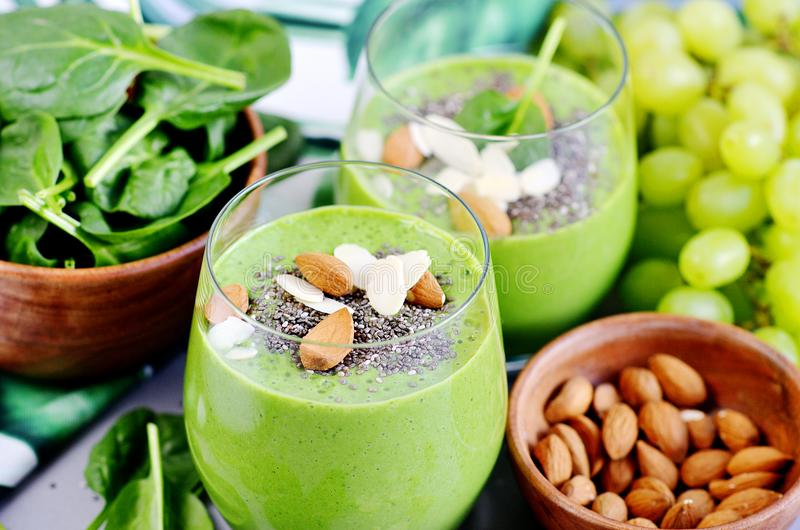 Green Smoothies Vegetables Spinach Apple Grape with Chia Seeds and Almonds. Healthy Food Concept, Detox stock photo