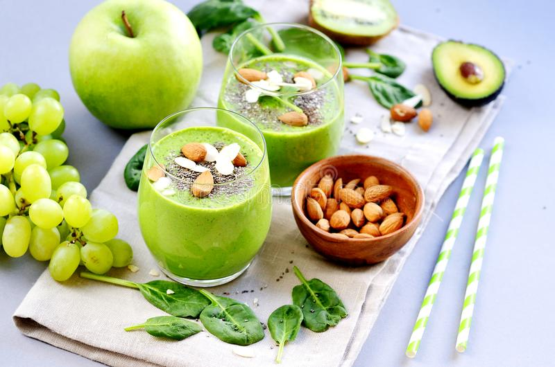 Green Smoothies Vegetables Spinach Apple Grape with Chia Seeds and Almonds. Healthy Food Concept, Detox stock photos