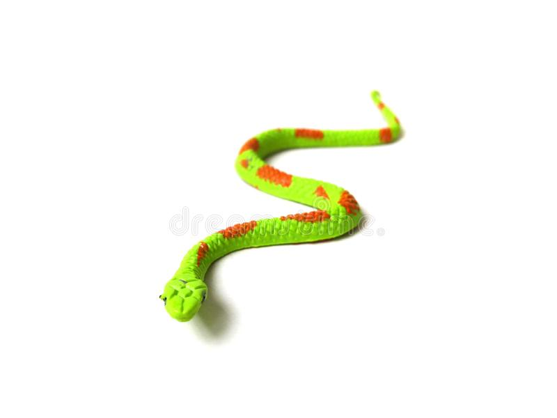 Green snake toy. Close up of rubber snake toy isolated on white background royalty free stock photos