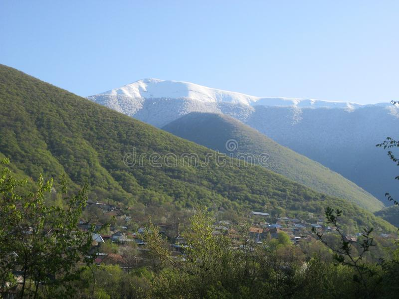 Green and snowy mountains of Sheki stock photography