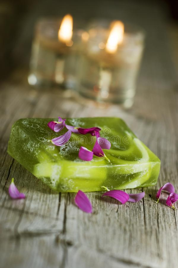 Green soap and candles royalty free stock photography