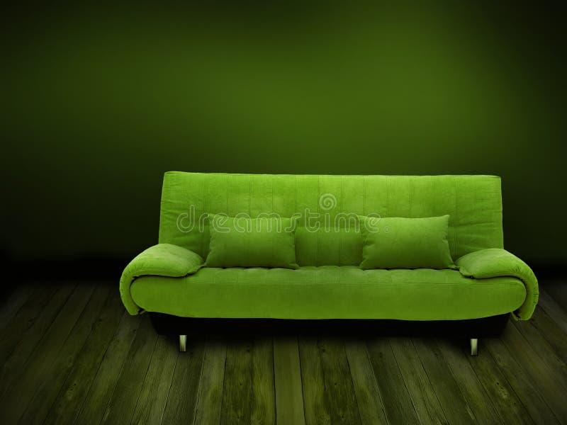 Green sofa. Wooden floor, green wall - indoor/ home background stock photos
