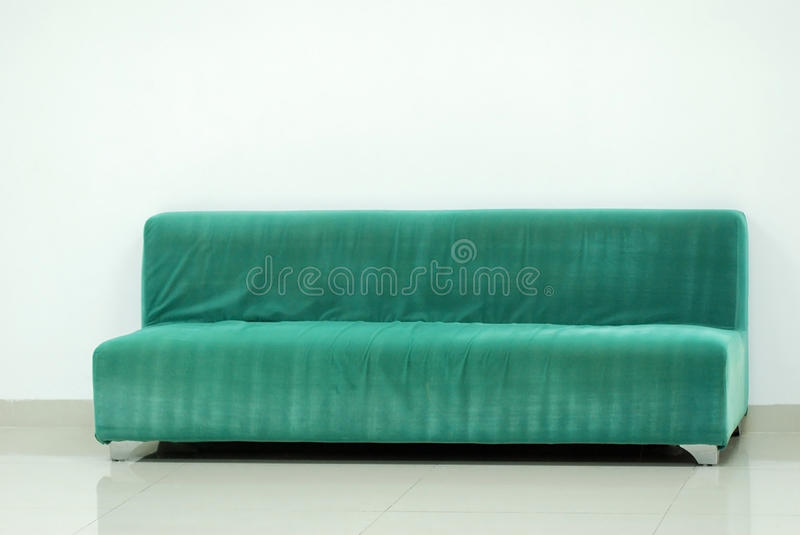 Green sofa. In the new house stock images
