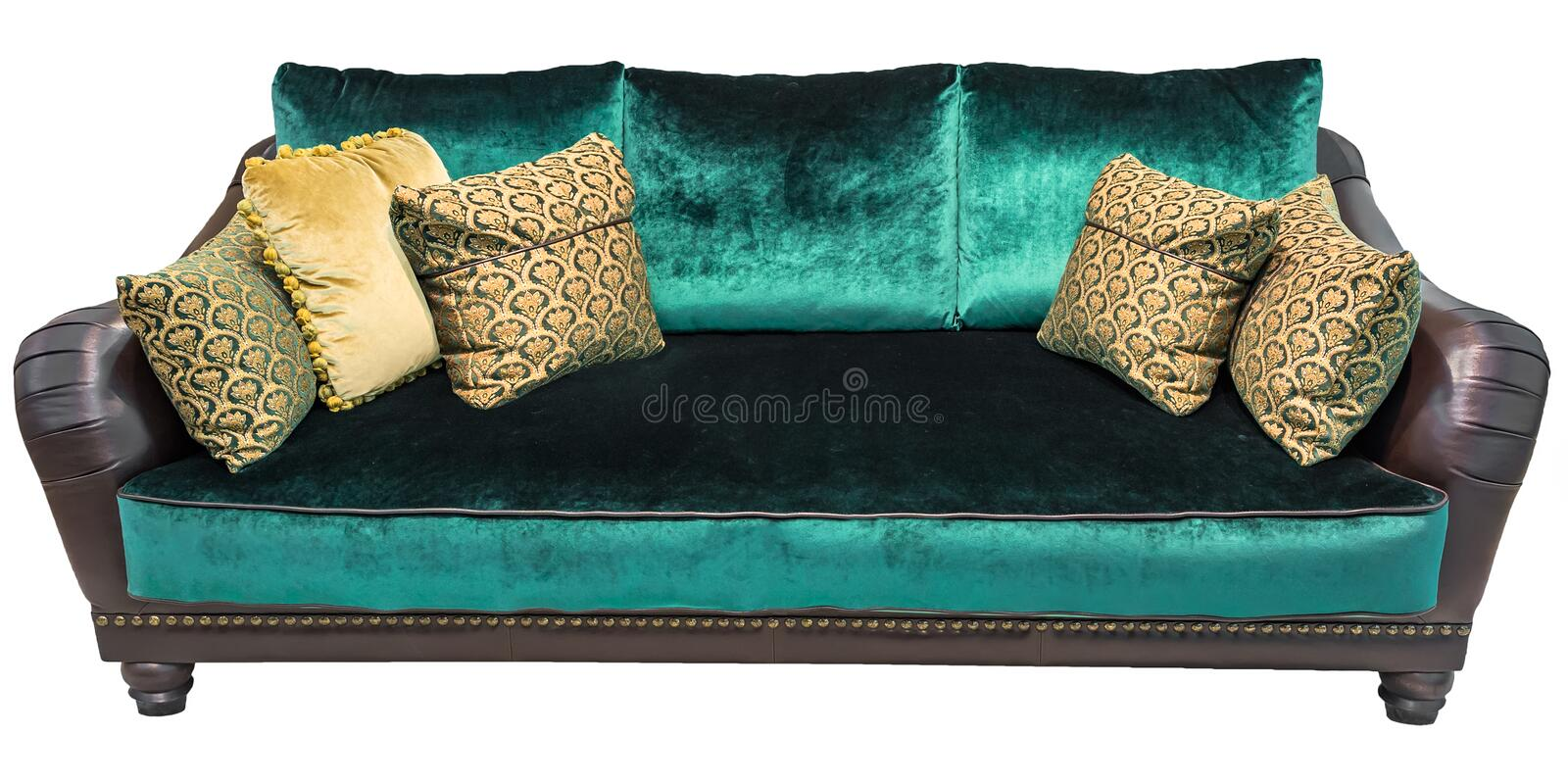 Green sofa with pillow. Soft emerald couch. Classic divan on isolated background. Velvet velor leather fabric sofa stock photography