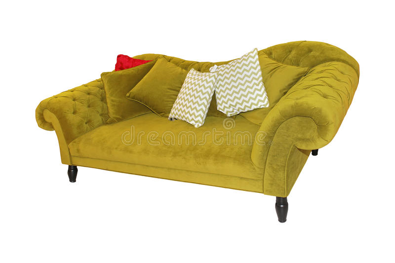 Green sofa. Vintage green sofa with decorative pillows isolated with clipping path included royalty free stock photo