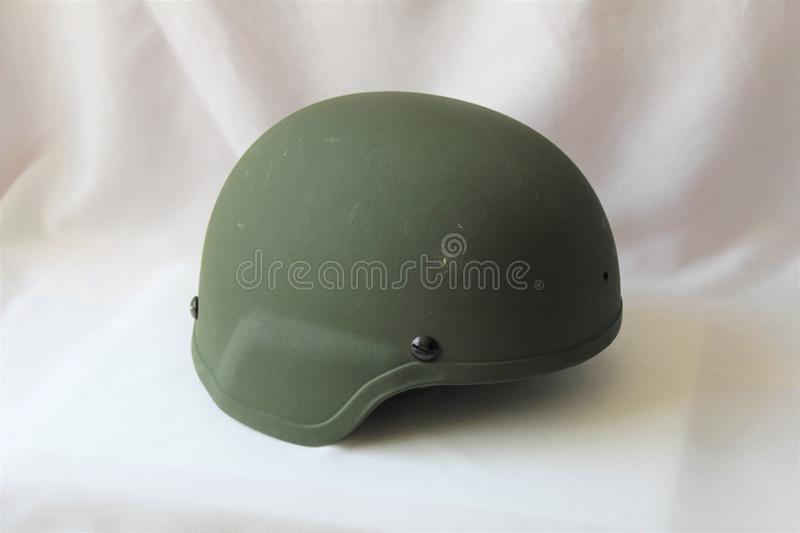 Green Soldier`s Helmet on White Background royalty free stock images