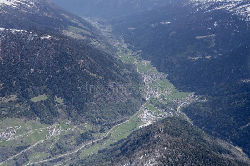 Green Sole valley, Trentino, Italy. Aerial shot , from a small plane, of green Sole valley , shot from west in bright spring light in Trento mountains, Trentino stock image