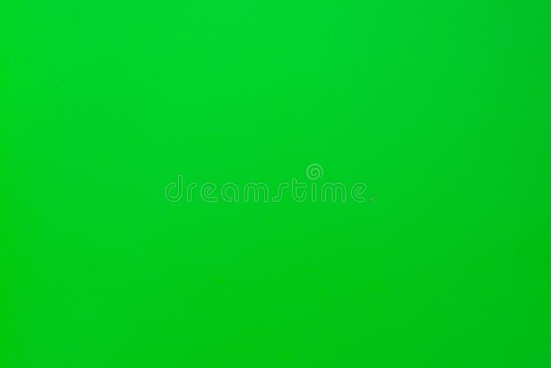 Green solid color background with matte texture. Wallpaper design. Green matte surface, abstract, bright, light, material, orange, colorful, art, bumpy, clean royalty free stock photography