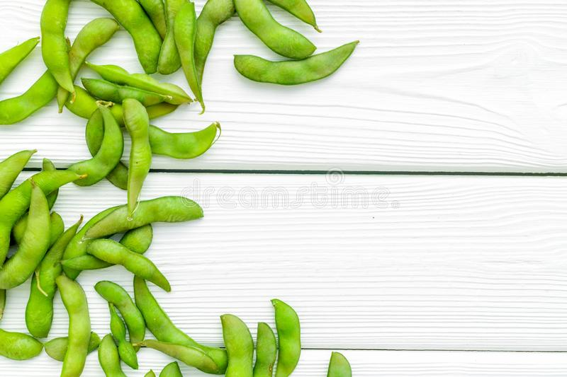 Green soybeans or edamame for fresh healthy food on white wooden background top view space for text stock photography